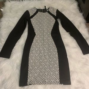 Black and white fitted knee length dress